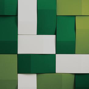Triline ljudabsorbenter i vitt och gröna kulörer